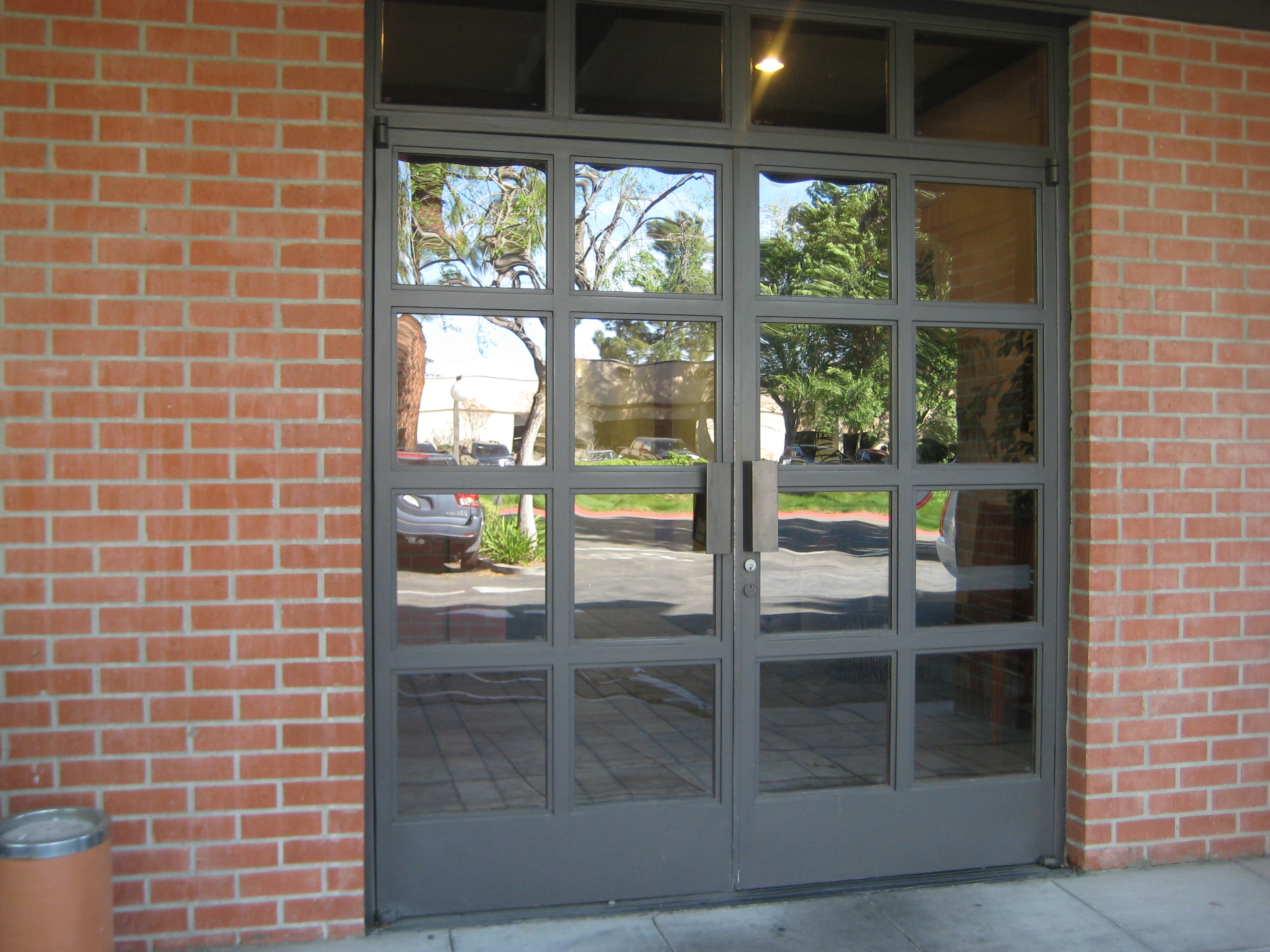 Commercial doors glass storefront windows metal security for Preferred windows and doors
